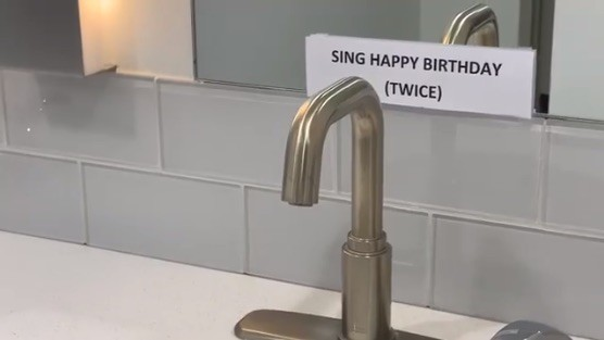 Faucet with sign behind it